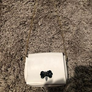 Cream colored gold chain purse